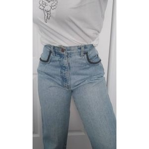 Vintage pale mom jeans with leather detailing